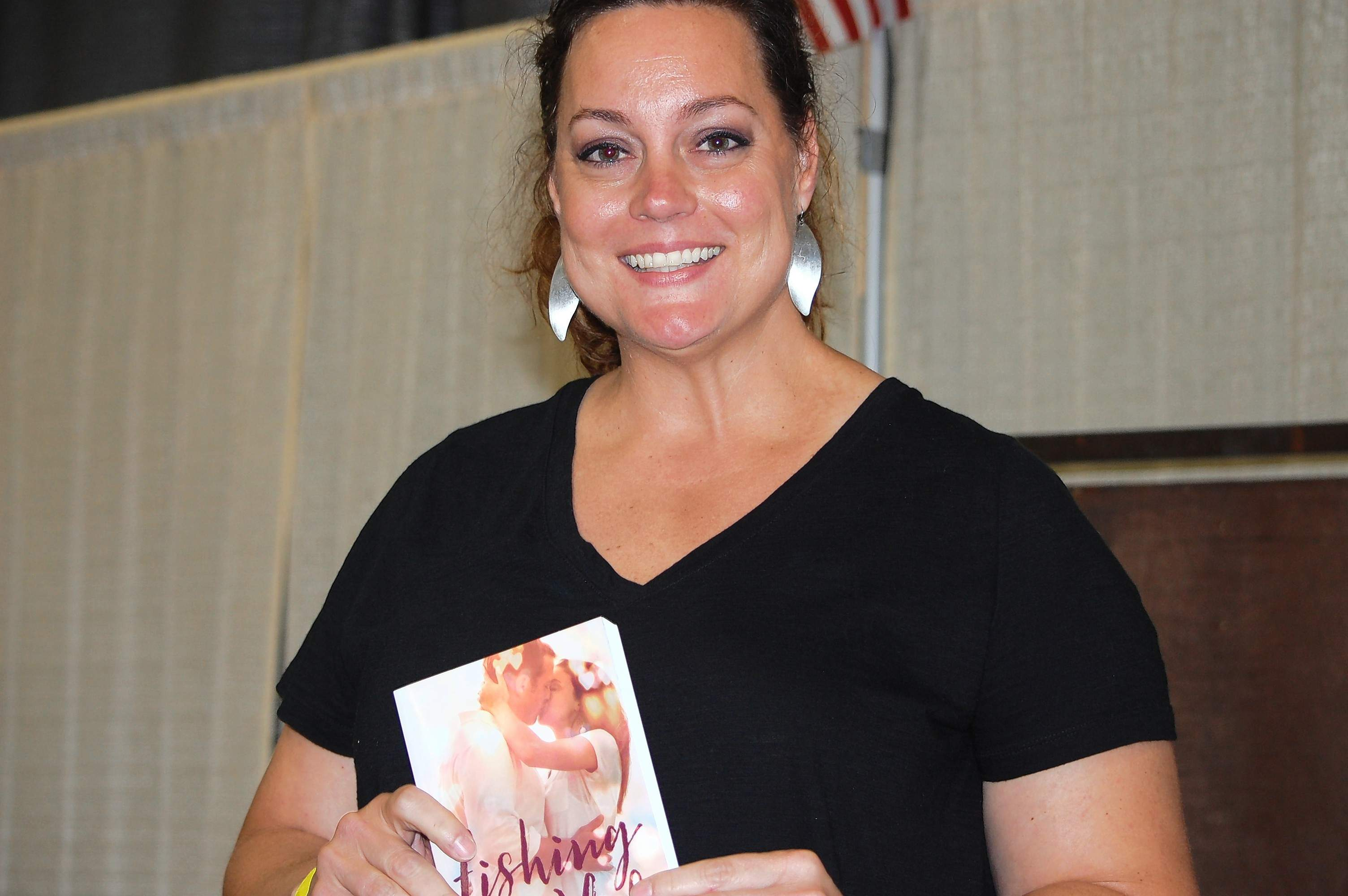Local author Hillary DeVisser holds one of her novels. DeVisser was one of the many vendors featured at the Southern Illinois Made Expo over the weekend at The Pavilion in Marion.