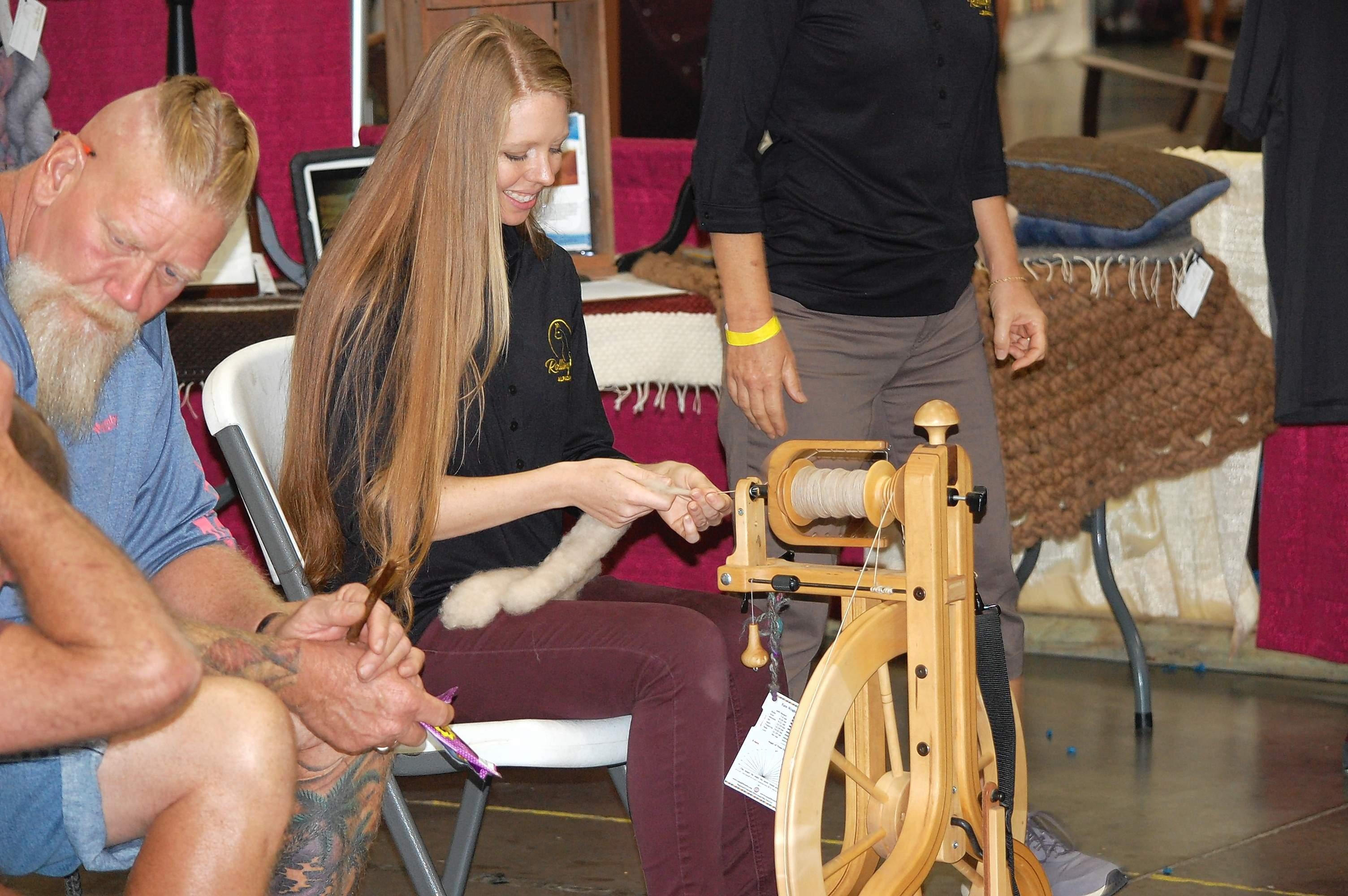 Morgan Stevenson of Rolling Oak Alpaca Ranch in Makanda spins alpaca hair into yarn Saturday at the Southern Illinois Made Expo.
