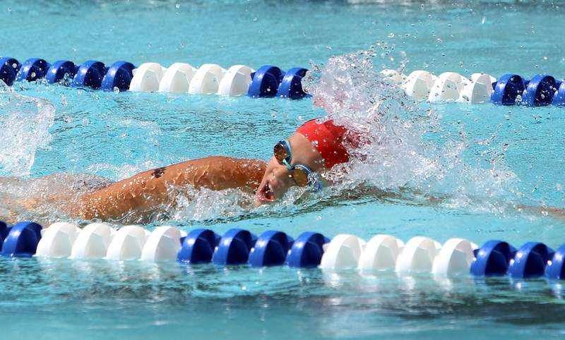 Mikah Montgomery swims a race during the SISL Championships on Saturday in Anna.
