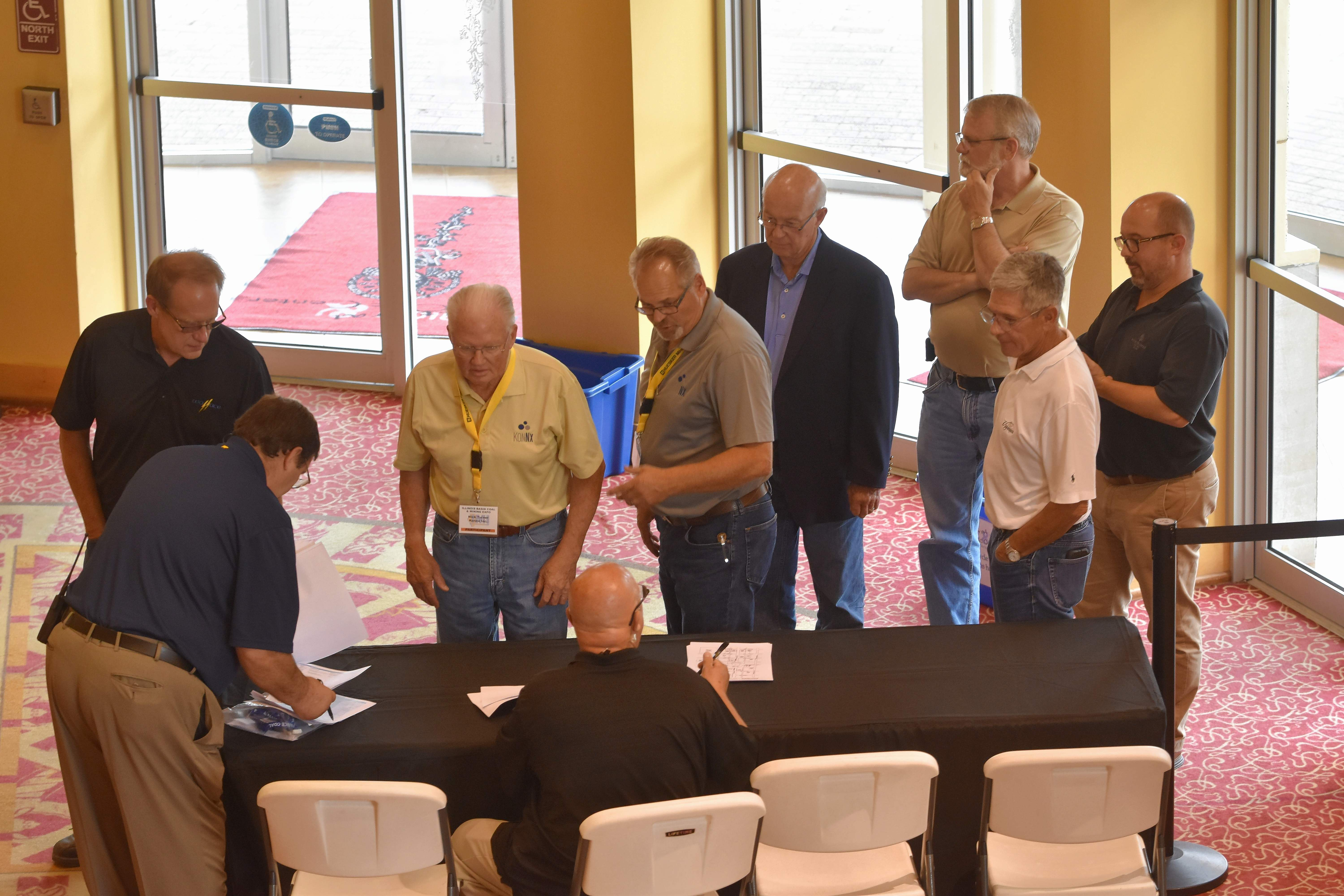 Attendees register for the Illinois Basin Coal and Mining Expo symposium Wednesday afternoon at the Marion Civic Center.