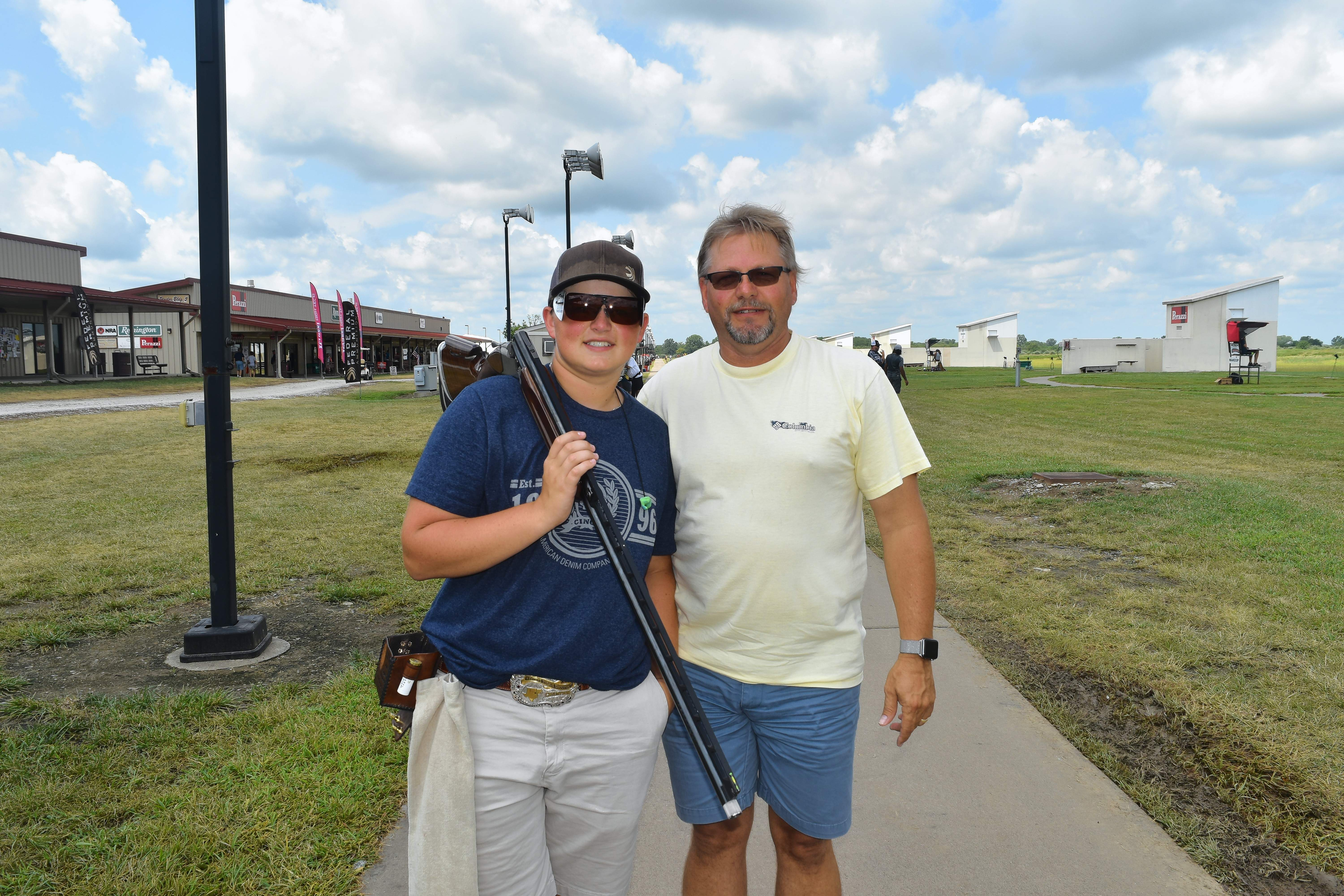 Clay Laughlin, 16, from Durant, Oklahoma, is shown here with his proud father, Tim, after Clay completed a practice round of shooting Wednesday at the World Shooting and Recreational Complex.