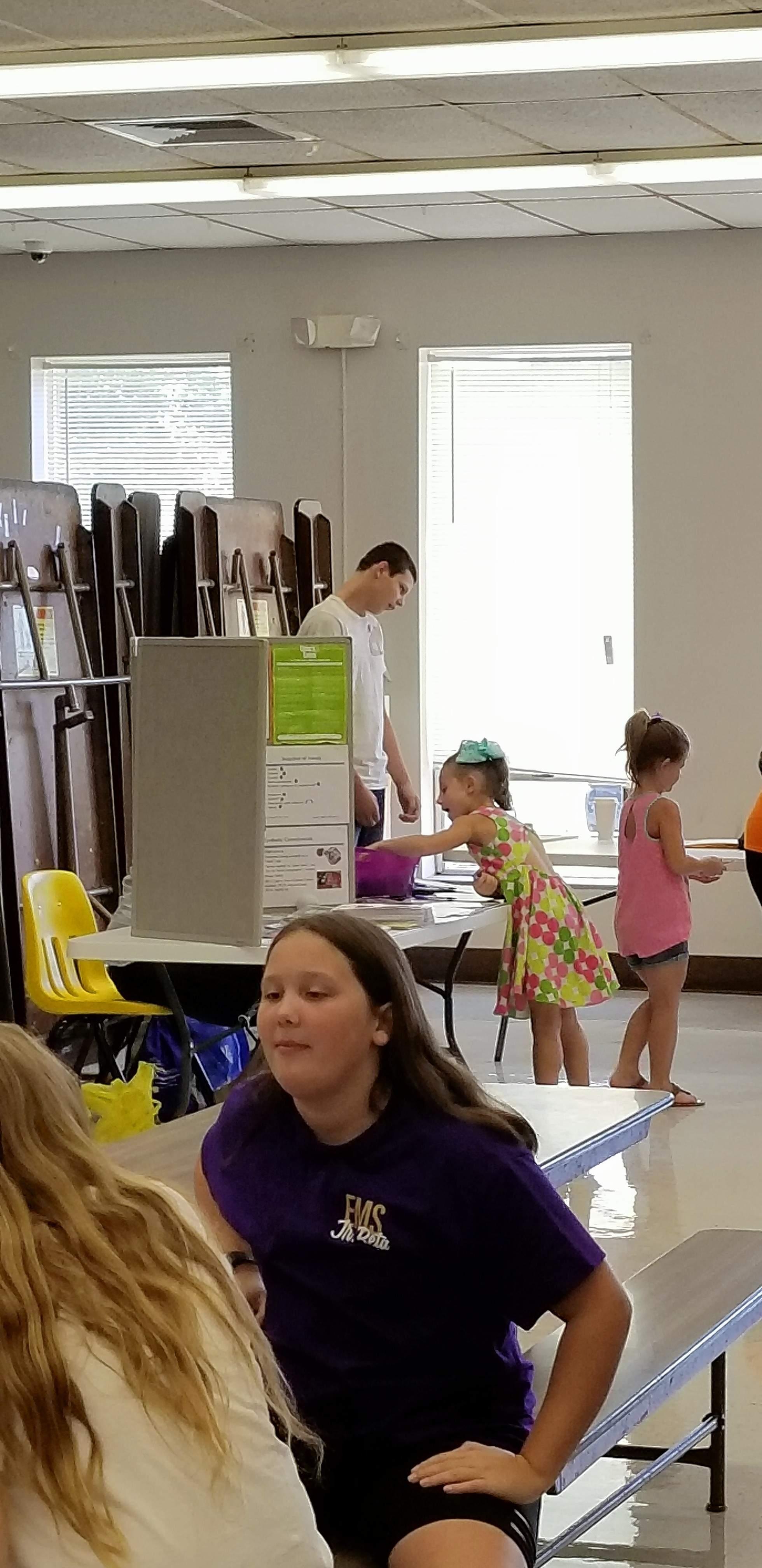 Junior Beta Club members assist during middle school registration.