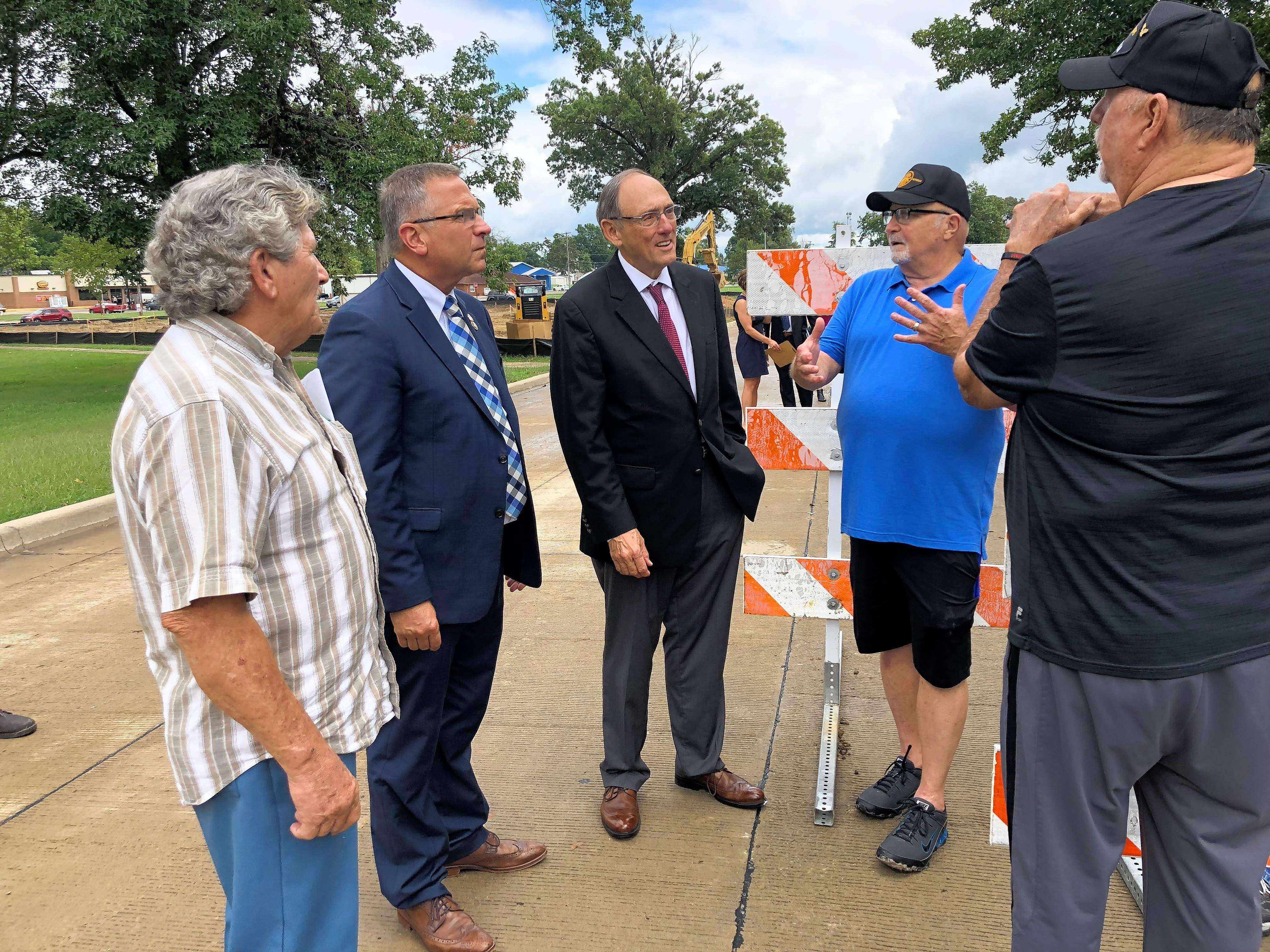 U.S. Reps. Mike Bost and Phil Roe listen to concerns raised by members of Point Man Watchdog on the grounds of the Marion VAMC. From left are Leonard Willis, Bost, Roe, Rocky Morris and Dink Broy.