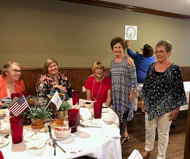 From left are club members Esther Bornert, Jan Cleveland (club president), Liz Garrett, Lennie Upchurch and Donna Hearn.