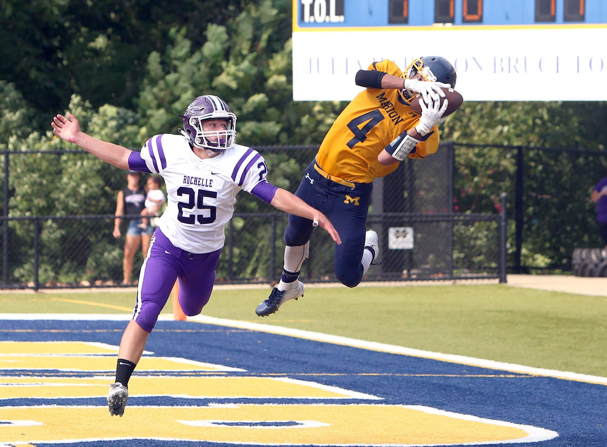 Dylan Kinell catches the game-winning touchdown in the final seconds Saturday.