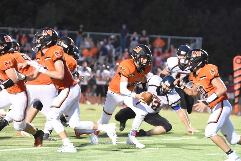 Chance Karnes takes a snap in Friday's game.
