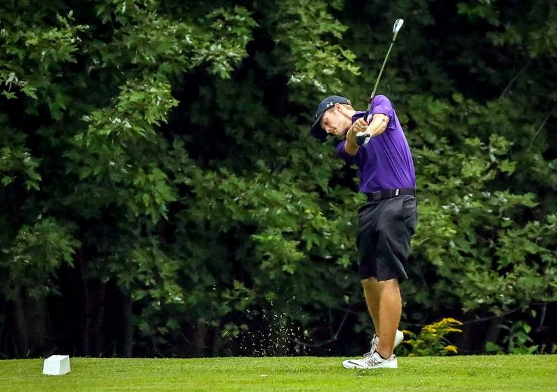 Evan Coyle watches this shot at a recent home match. Coyle came up with a 42 in last week's match against Carmi-White County.