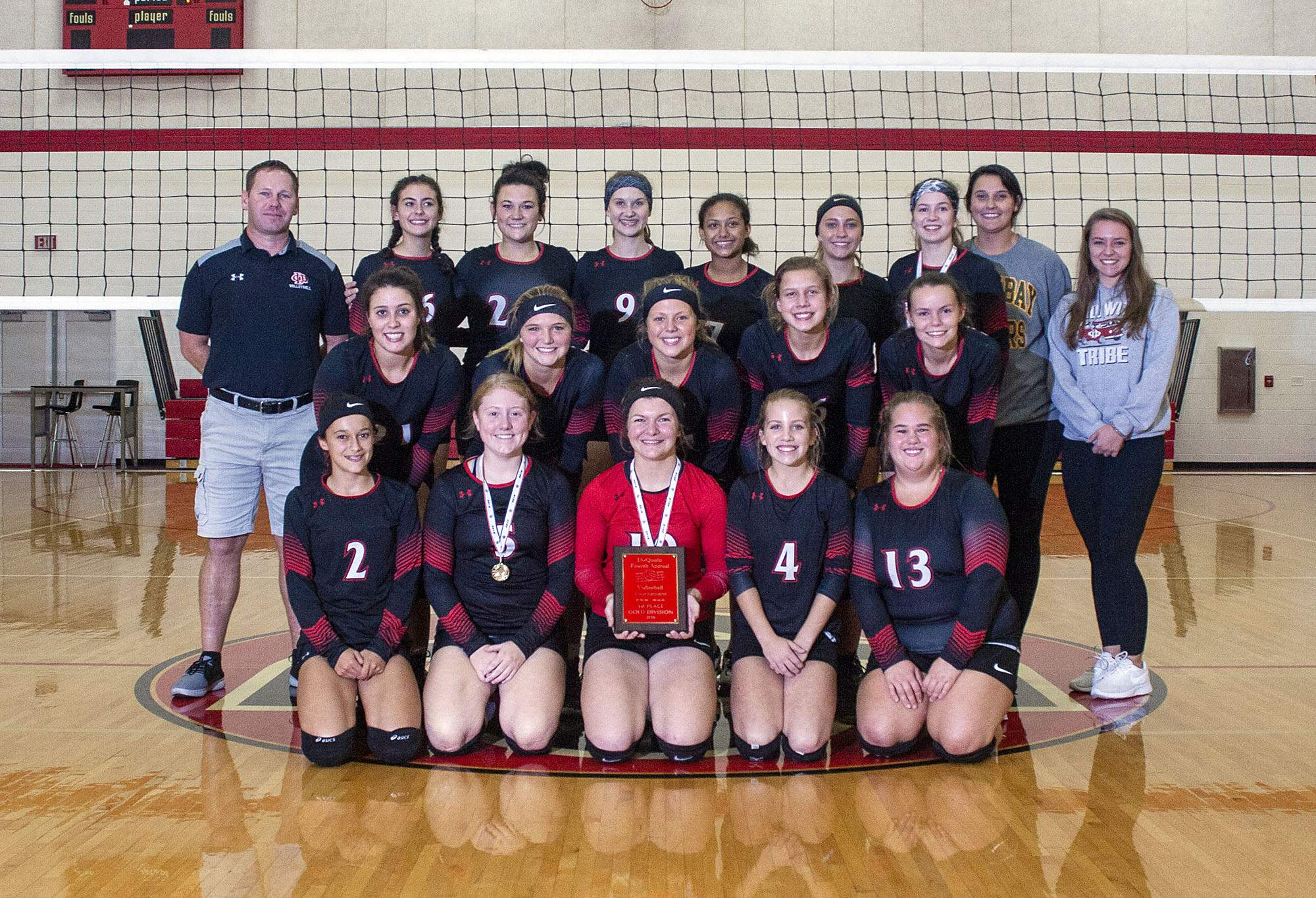The Du Quoin High School volleyball team poses with the Du Quoin Invitational championship plaque Saturday.