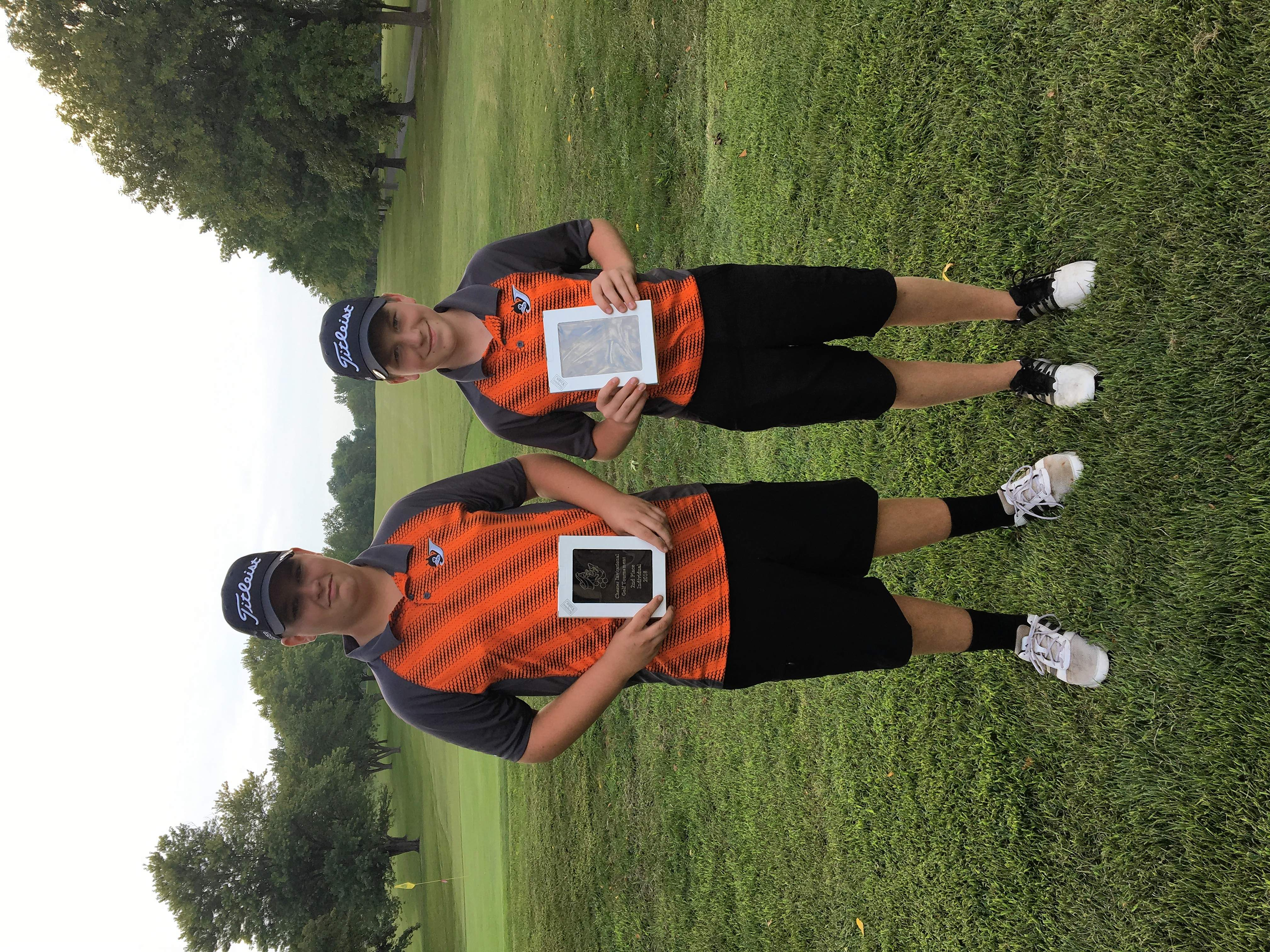 Chester golfers Jaden Mott, left, and Jarrett James display the plaques they won by finishing in the Top-5 golfers at the 2018 Chester Invitational Golf Tournament Aug. 30. For the 18-hole match, Mott shot 85 to tie for 5th and James shot 78 to tie for runner-up in the event.
