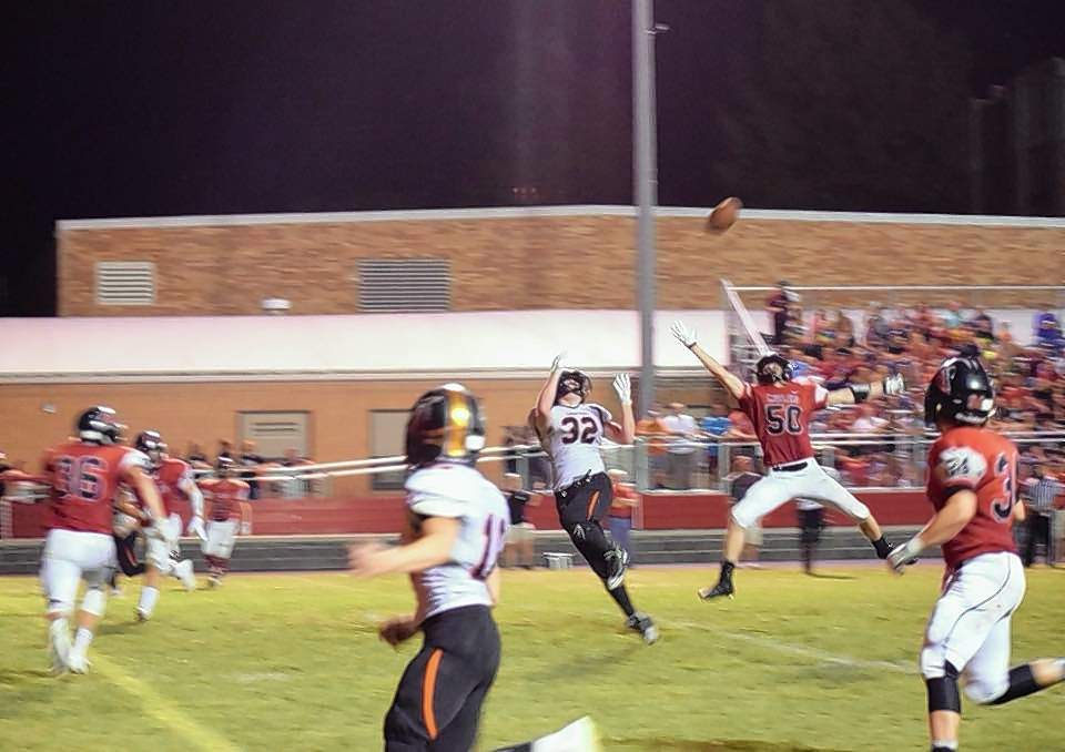 Chester's Drake Bollman (32) catches a 21-yard touchdown pass from Jacket quarterback Nick Meyer late in the second quarter at Fairfield Friday August 31. The TD brought the Jackets within two points, 22-20 to end the half.