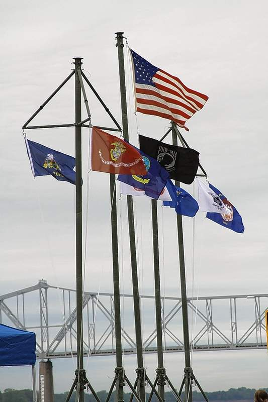 The American flag flies with flags of the U.S. military branches during the last visit of LST 325 in Chester in 2011.