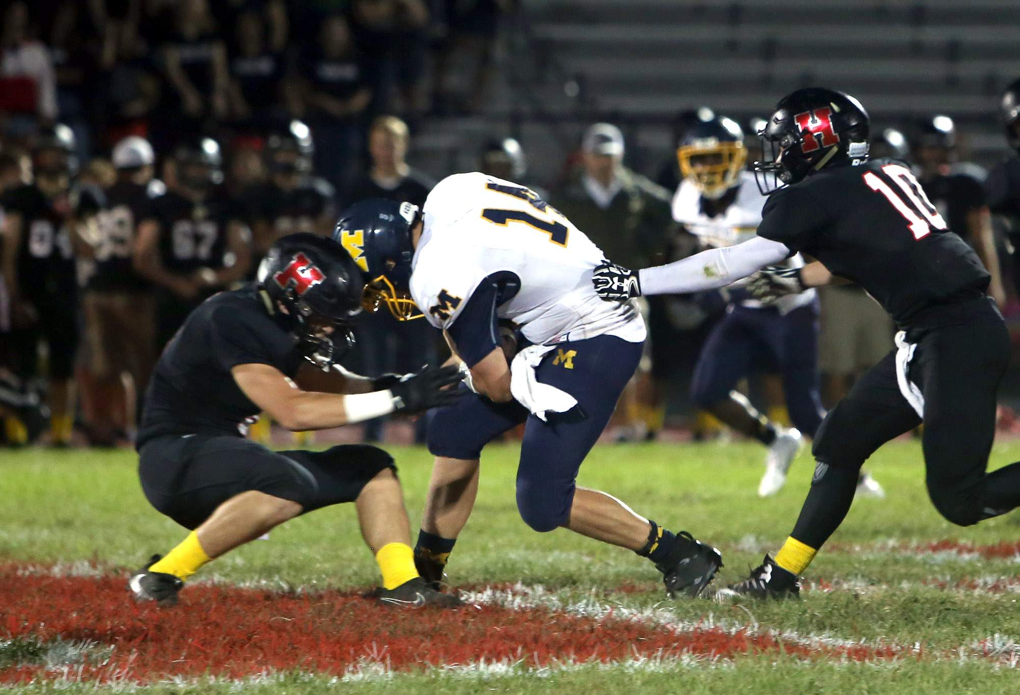 Boston Ziegler gains tough yardage Friday night against Highland.