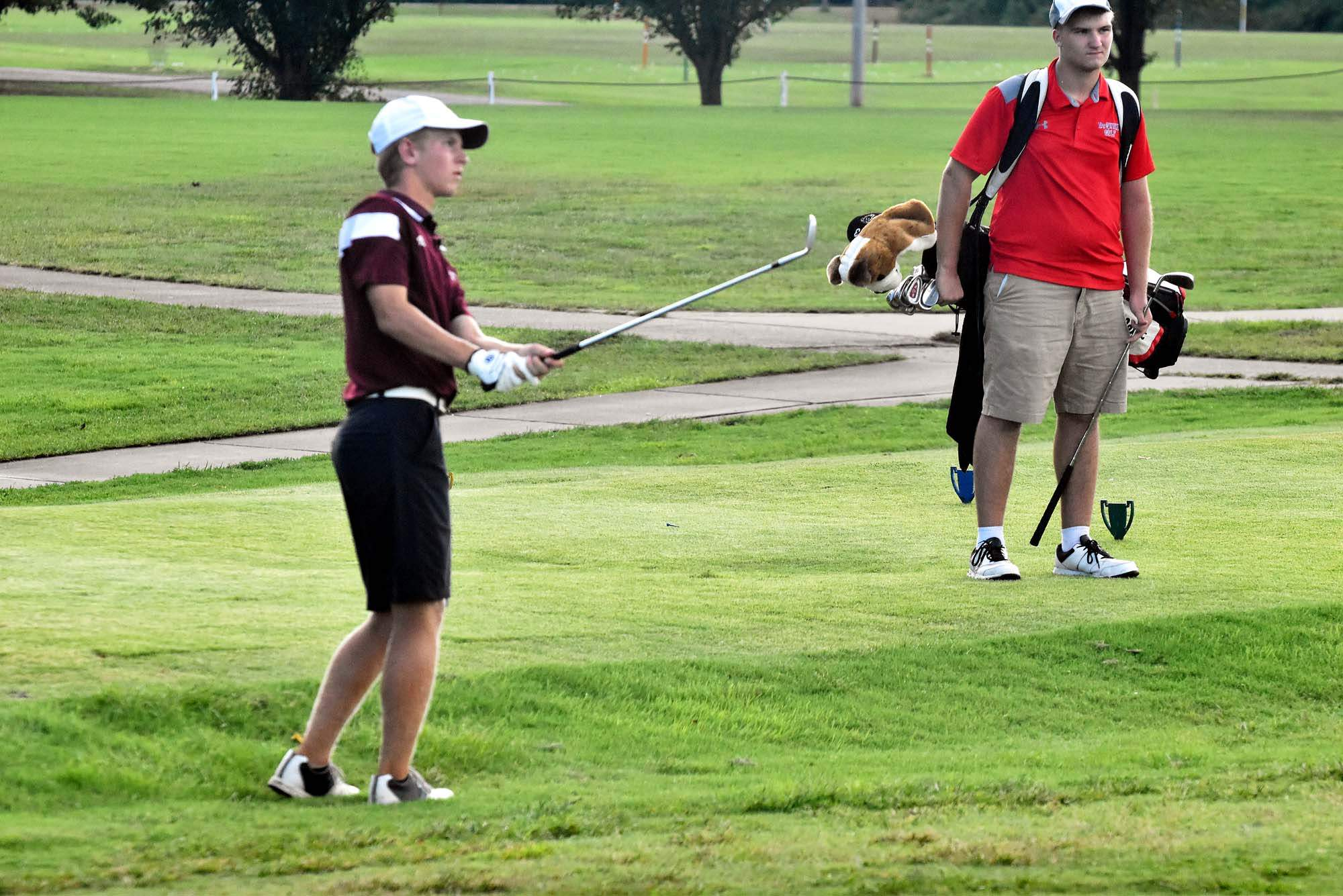 Benton High School golfer Jared Shaw chips from the fringe on the ninth hole at the Benton Country Club during a quadrangular match last week. Shaw stroked a 38 for the Rangers.