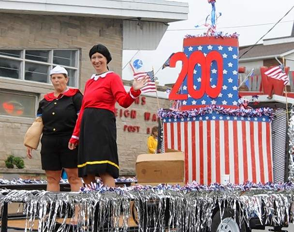 "Chester Memorial Hospital's float at the 39th Annual Popeye Picnic parade carries the festival's theme ""Popeye Celebrates the Bicentennial; Where Illinois Began."""