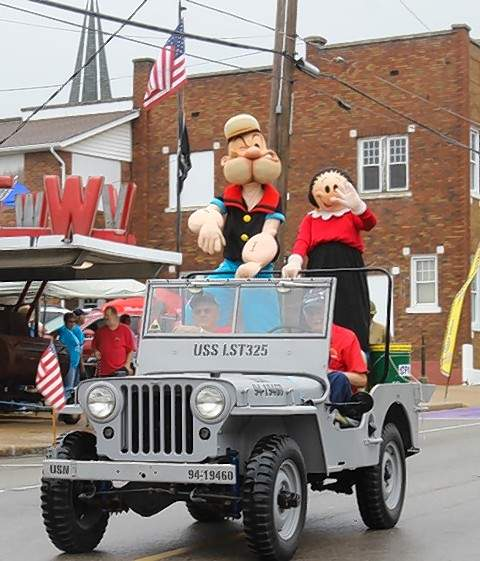 Popeye and Olive Oyl lead the 39th Annual Popeye Picnic parade Saturday, with help from members of the LST 325 World War II landing craft exhibit, which was among the weekend's events.