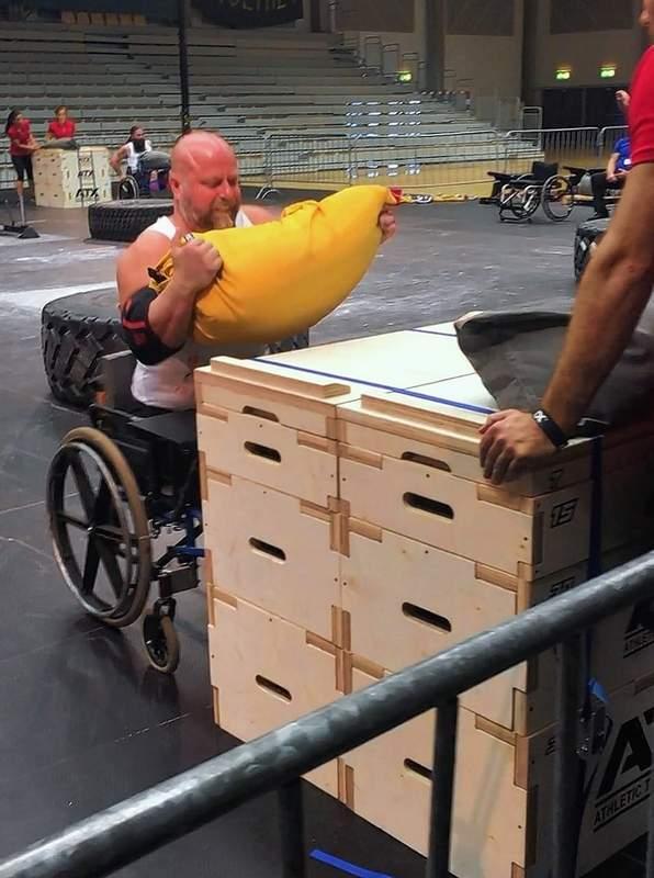 Brad Vinyard competes in the sandbag stacking medley event.