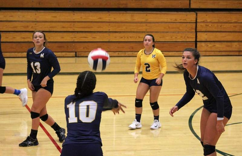 Ivy Smart bumps the ball surrounded by teammates Kaylee Evans, Jordan Turner and Kylie Plant on Monday in Salem.