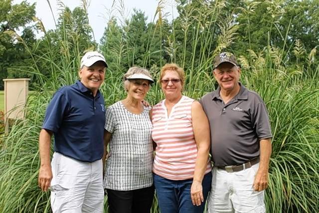 A Flight winners were, from left, Ron Nitzsche, Jeannie Kleinschmidt, Kathy Brown and Joe Severs