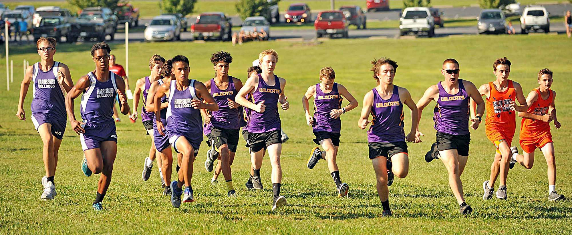 JEFF JONES Runners from Harrisburg High School and Carrier Mills Stonefort High School along with schools from Galatia, Gallatin County, Massac County cross the starting line at the cross country course at Southeastern Illinois College Tuesday evening.