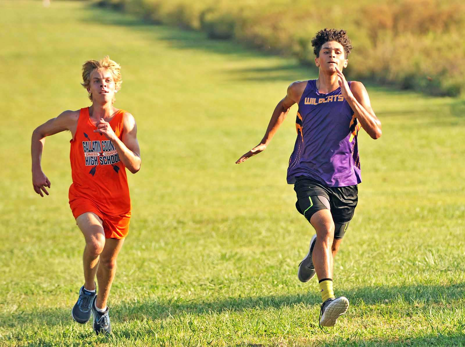 Gallatin County's Will Henson and Carrier Mills-Stonefort's Aidan Rollins compete in Tuesday's Harrisburg Invitational.
