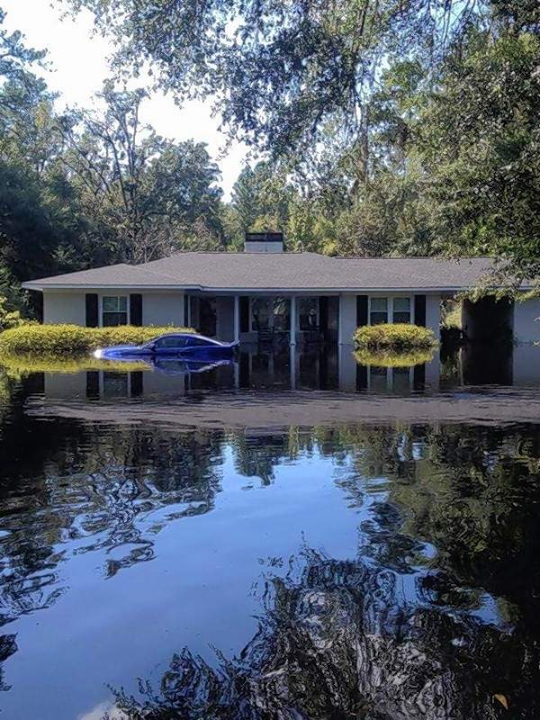 A home in Nichols, South Carolina, sits surrounded by flood waters left in the wake of Hurcane Florence.  The flooding is expected to worsen as three rivers surround the area continue to rise.