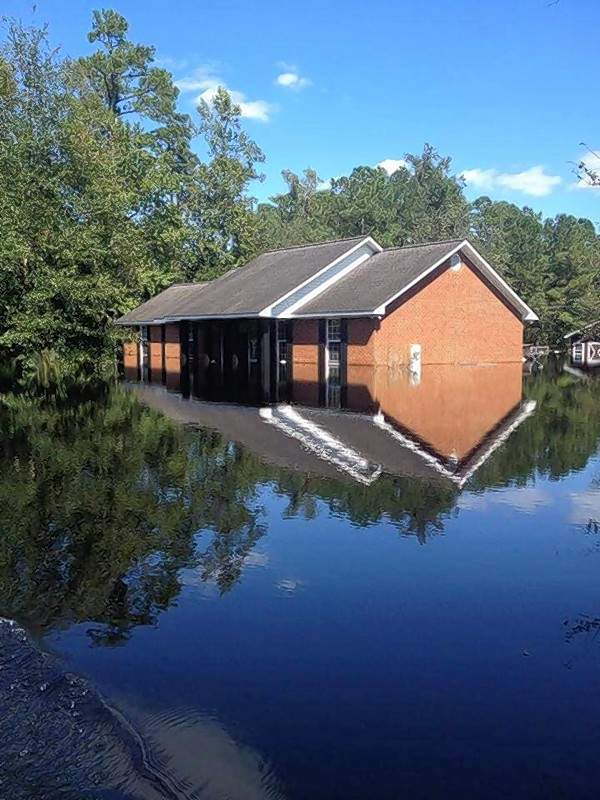 A home in Nichols, South Carolina, sits surrounded by flood waters following Hurricane Florence.  The small town has been virtually destroyed, according to Brooke Wright, a Johnston City native now residing in neighboring Dillon.