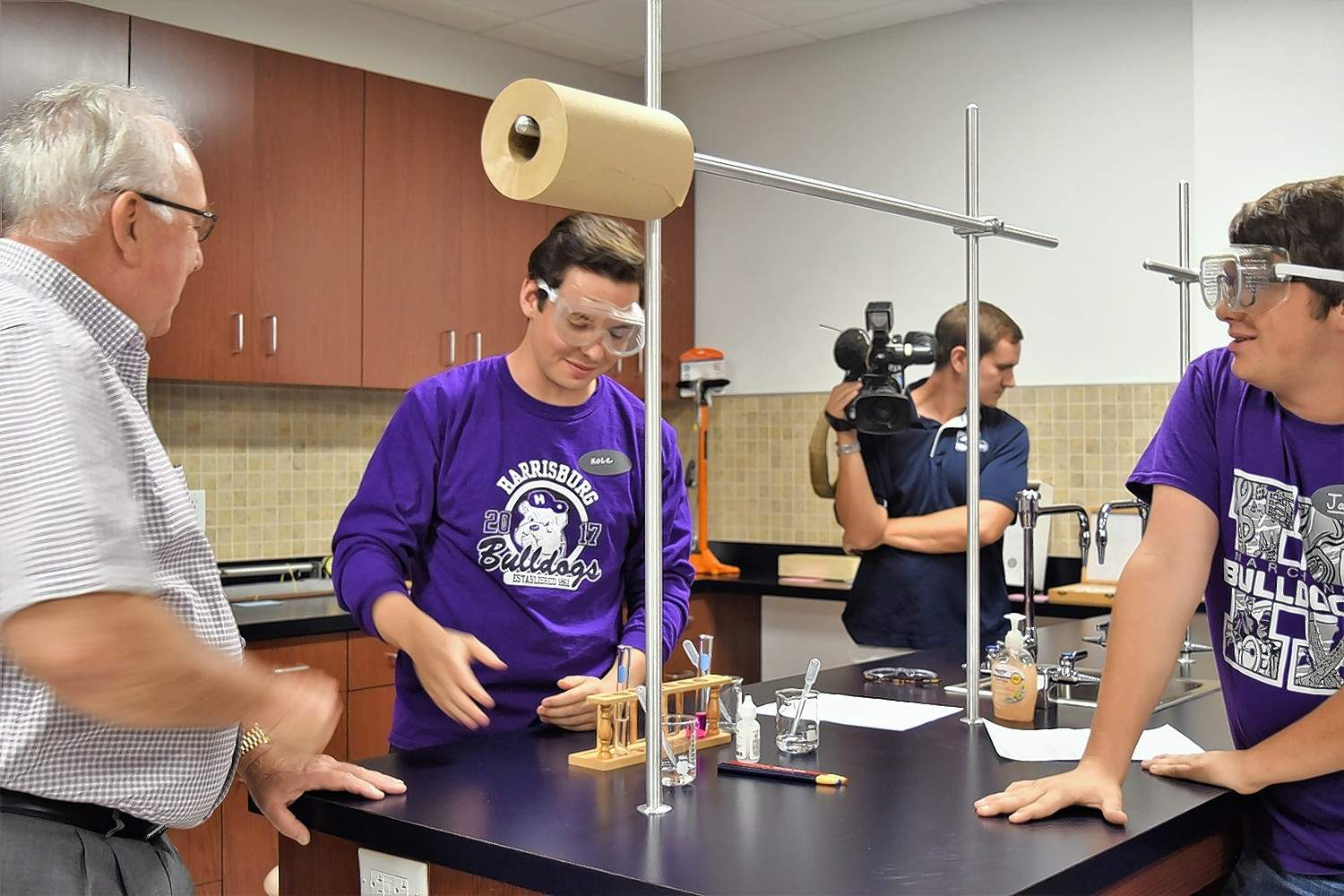 Seniors Kole Phelps, center, and Jack Gulley give a demonstration of science equipment to Paul Jones, left.