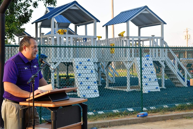 Eldorado Superintendent Ryan Hobbs speaks Thursday evening in a ceremony opening Eldorado Grade School's new playground equipment.