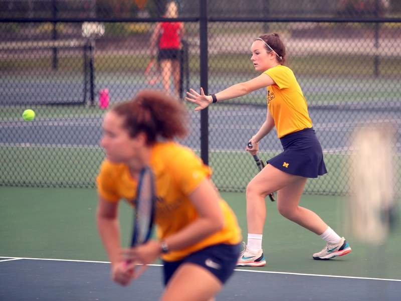 Paige Newlin waits to hit a return with Sophia Arnold at the net in Wednesday's match against Centralia.