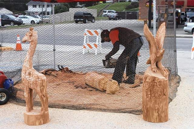 The Robinson family chainsaw wood carving sculpturers of Missouri work on carvings at the Steeleville Oktoberfest. A new attraction this year, the Robinsons are the only family in the nation that does this form of wood art as a family.