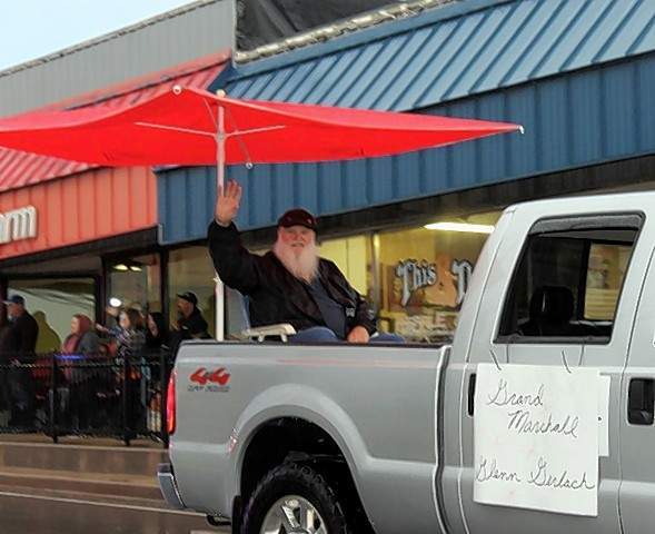 "The First State Bank of Campbell Hill's float, above, had a ""Cheers"" theme at the Oktoberfest parade, Parade Marshall Glenn Ray Gerlach, right,  waves to the crowd at the parade."