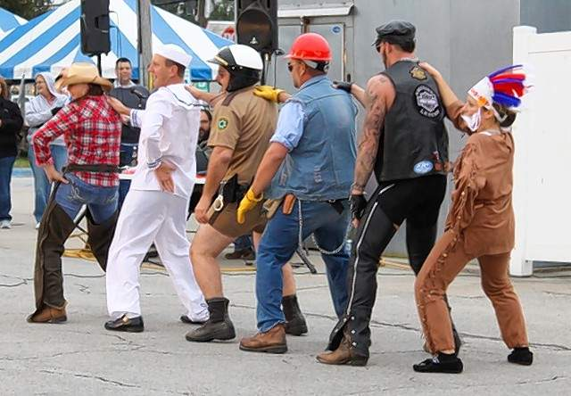 A group performs as the Village People during the Jaycees Oktoberfest annual Variety Show.