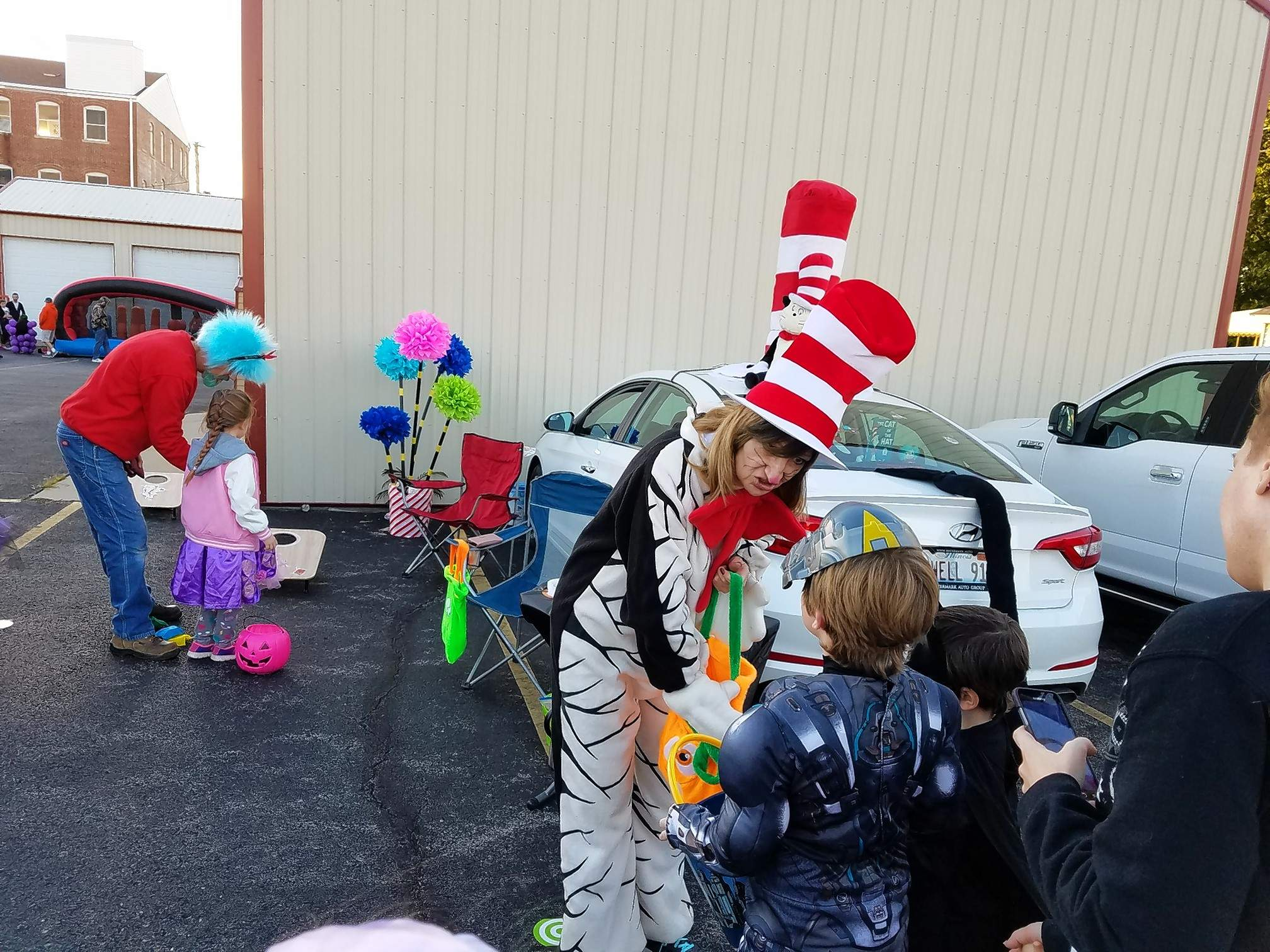 Gail Ewell, dressed as The Cat in the Hat of Dr. Seuss fame, passes out candy at the Halloween Trunk or Treat celebration Saturday hosted by the First Baptist Church of Marion.