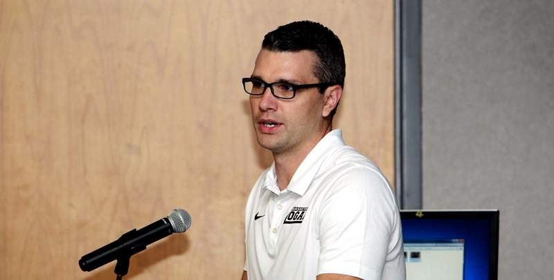 John A. Logan College head coach and Harrisburg High School graduate Kyle Smithpeters speaks during Monday's Media Day held at the school's Carterville campus.