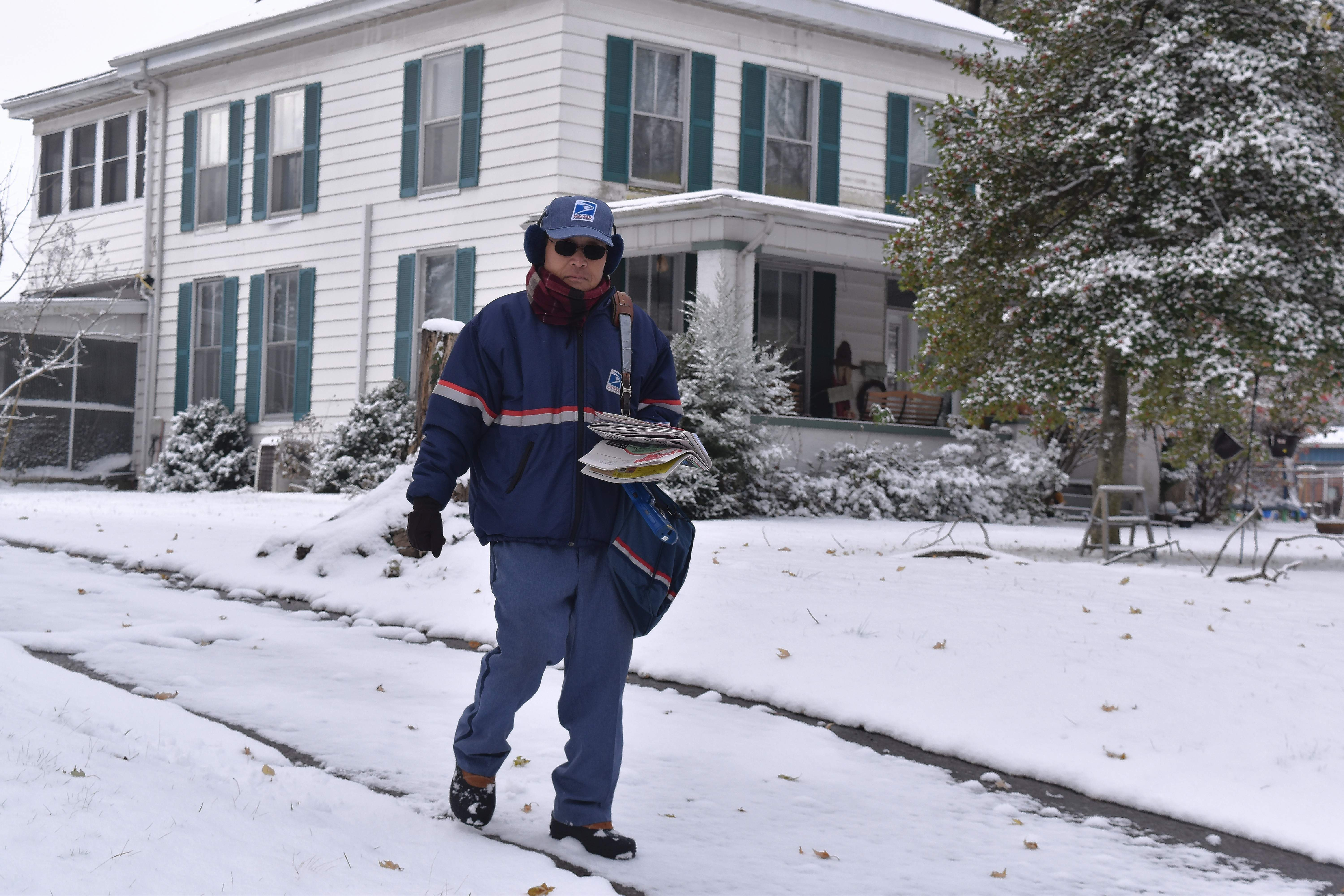 Du Quoin Post Office letter carrier Yang Kim was busy making his deliveries Thursday morning following the region's first real snow of the winter season.
