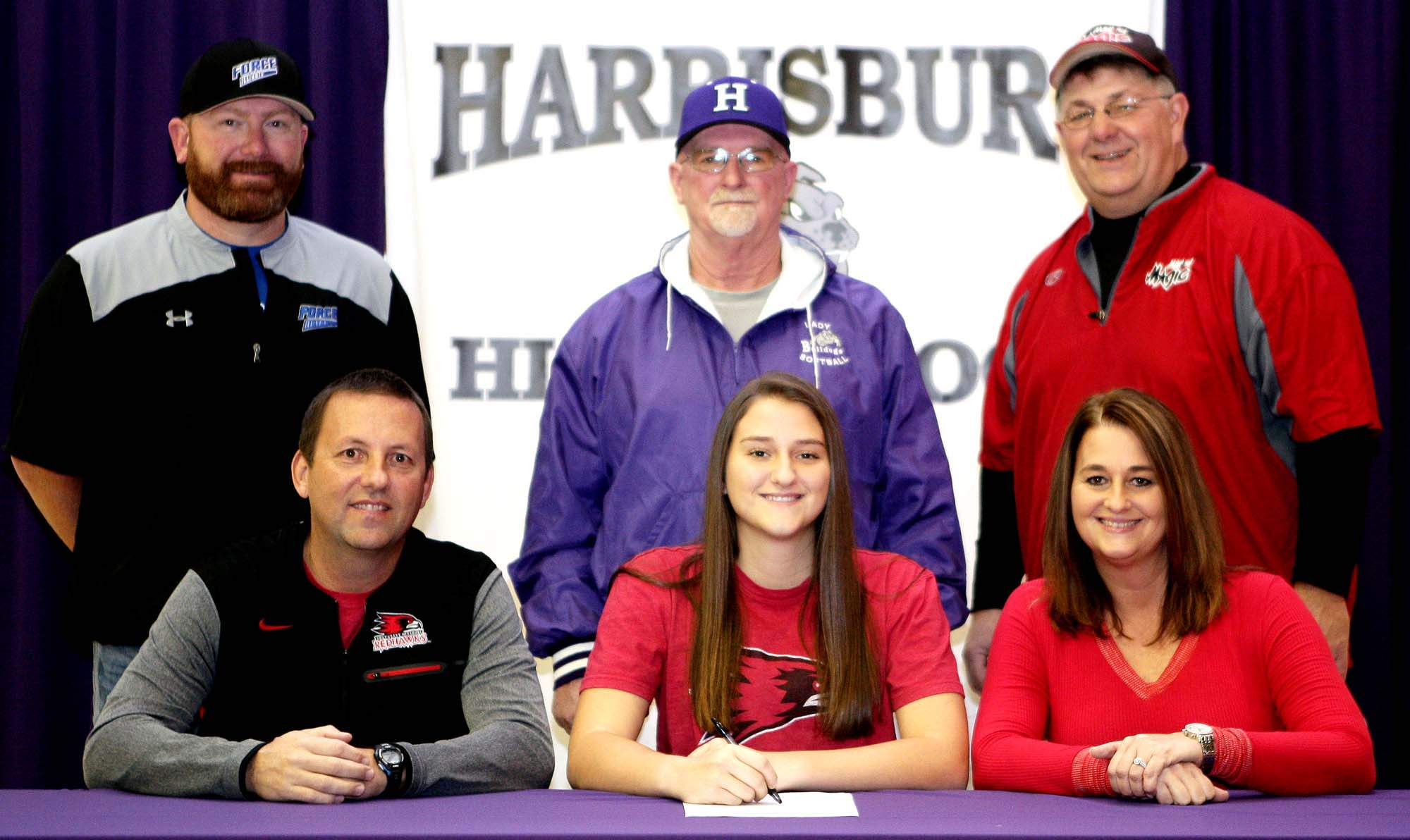 Karsyn Davis recently signed her Natiional Letter of Intent to play softball at Southeast Missouri State University. Pictured with Davis at her signing are (from left) Greg Davis (father) and Kim Reeder (mother). Back row, from left, Brett Sullivan, Red Stafford and Tony Moll.