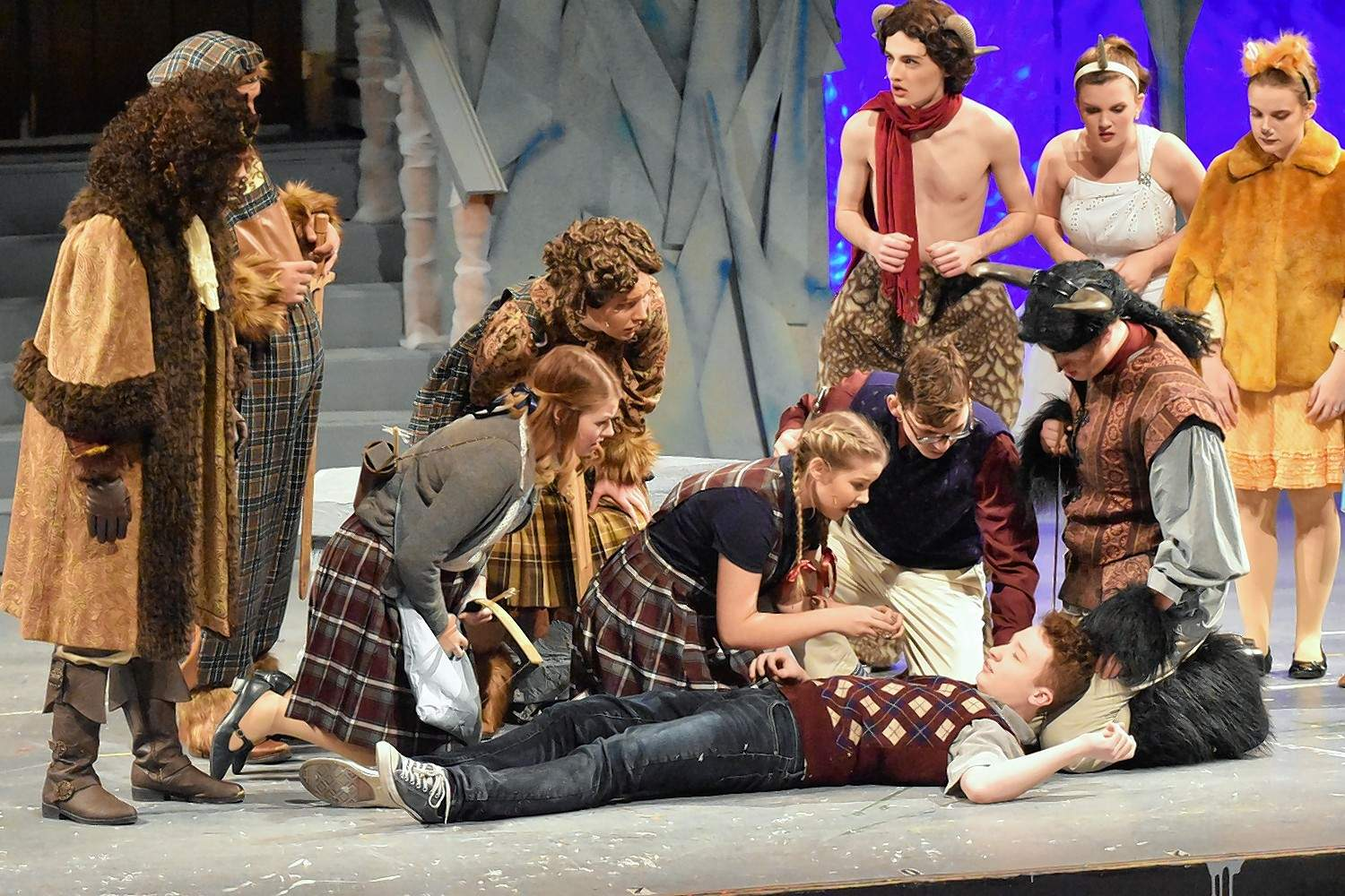 "Edmund (Carter Reed) is revived after the final battle scene in the musical ""Narnia."""