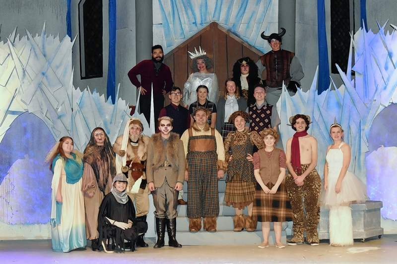 """Members of the cast of """"Narnia"""" gather for a photo following a technical rehearsal."""