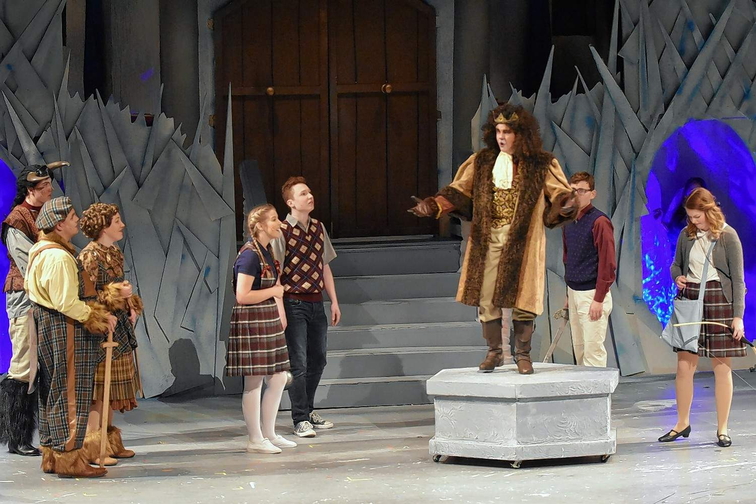"Aslan, portrayed by Braden Cummins (on pedestal), returns near the end of the musical ""Narnia"" staged at SIC."