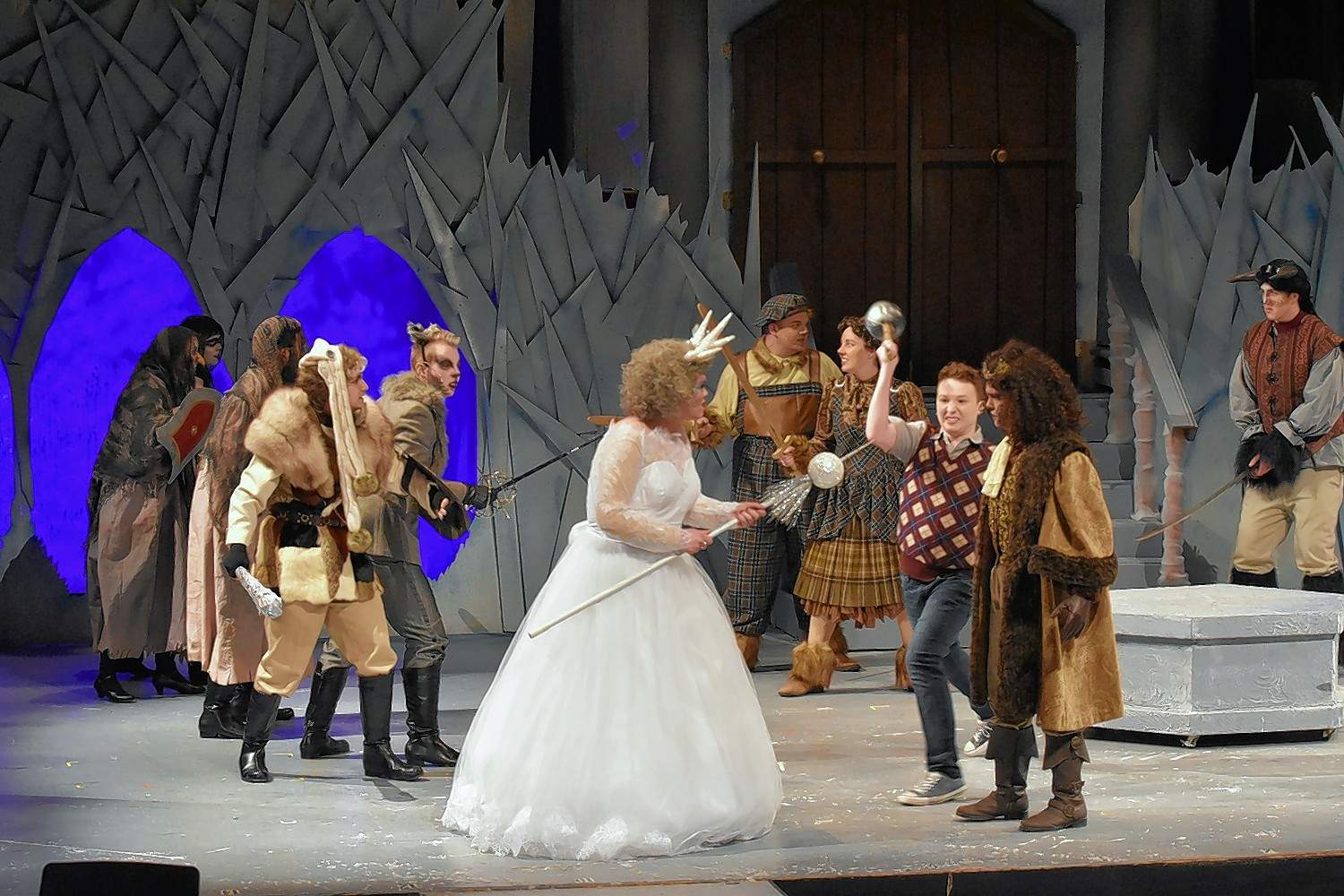 Edmund (Carter Reed) defends Aslan (Braden Cummins) from the White Witch.