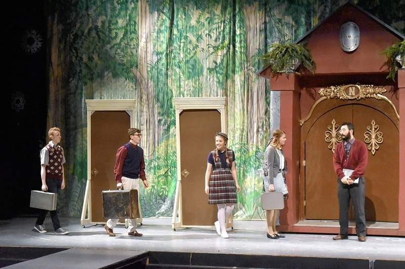 Edmund (Carter Reed of Harrisburg), left, Peter (Jordan Richey of Benton), Lucy (Paige Clore of Norris City), and Susan (Kady Lampley of Benton) arrive at the home of their uncle, portrayed by John Suh of Zeigler.