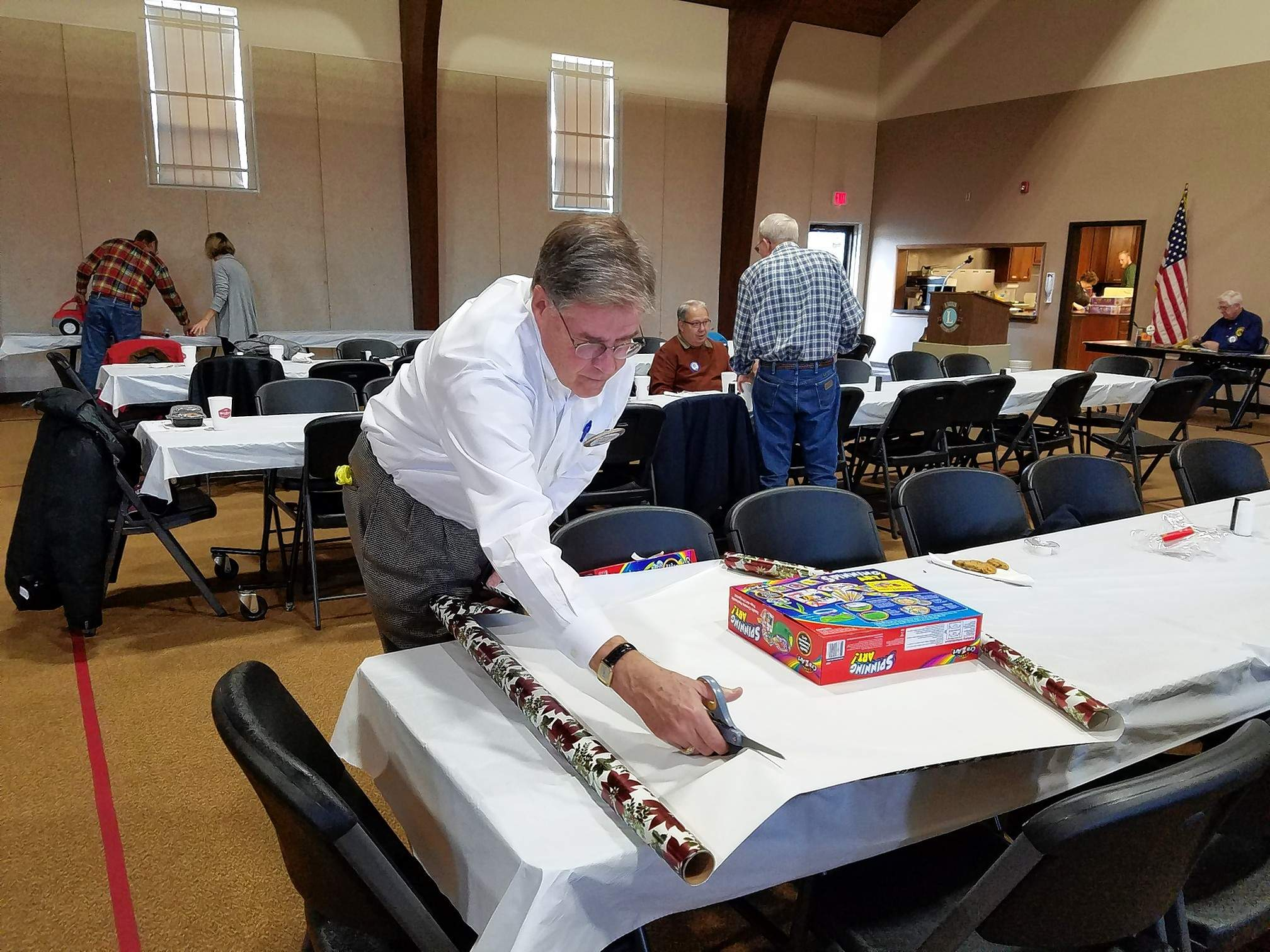 Marion Lions Club member Hayden Gardiner shows off his present-wrapping technique at Wednesday's club meeting.