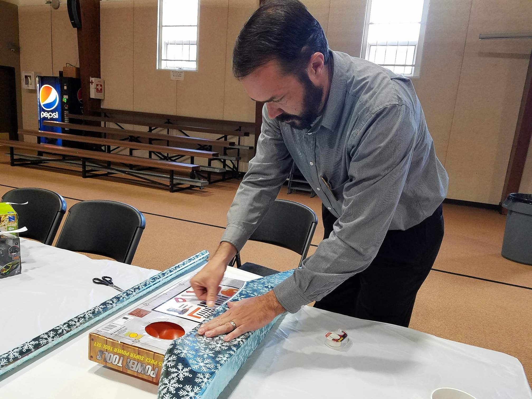 Marion Lions Club member Brad Miller was busy wrapping Christmas presents for children at Wednesday's club meeting.