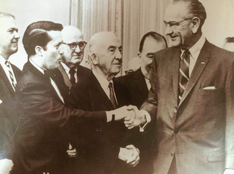 Kenneth J. Gray, the 'Prince of Pork,' shakes hands with Lyndon B. Johnson, known for his wheeling and dealing in the U.S. Senate.