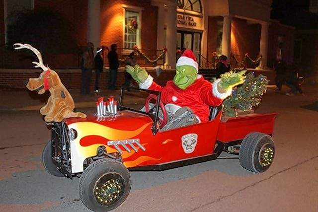 The Grinch (and his hood ornament, Max) makes an appearance in the Lights parade.
