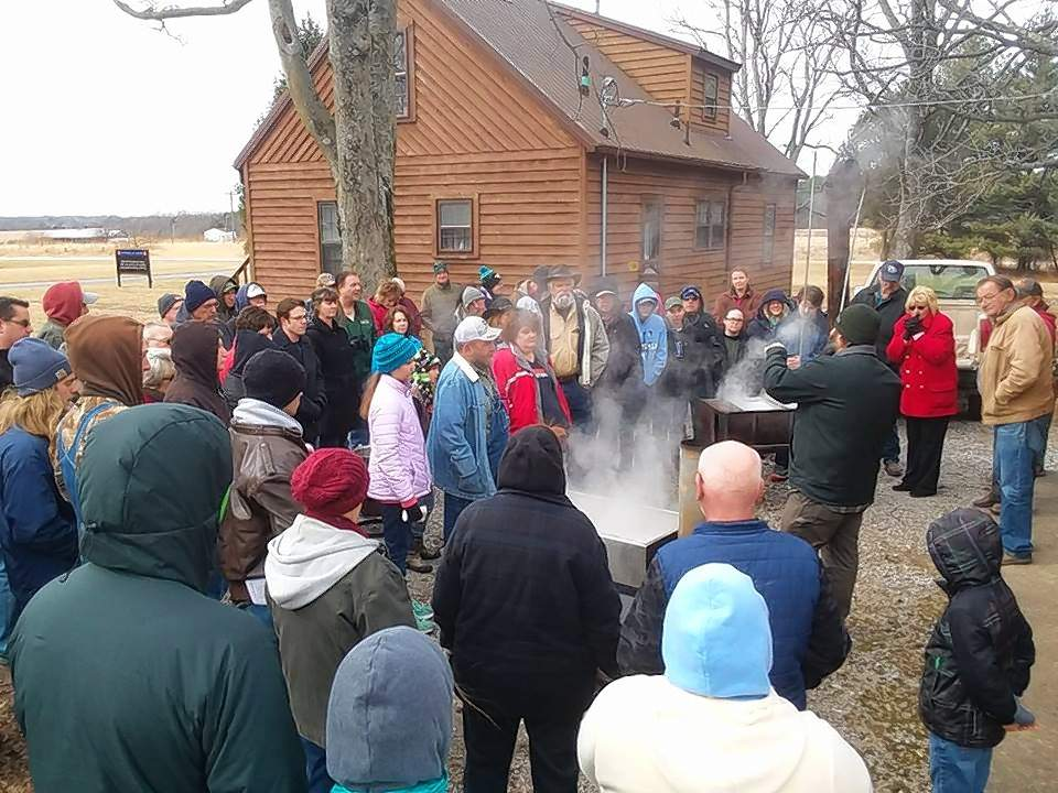 U of I Extension workers demonstrate how to make maple syrup at the 2018 maple syrup workshop.