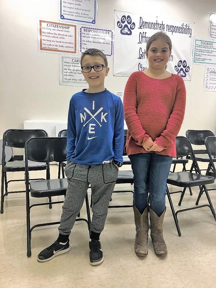 From left, third grade spelling bee winner Eli Oshel and runner-up Jaylee Evans.