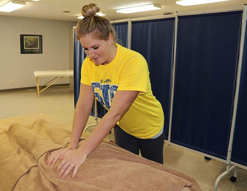 PHOTO COURTESY OF SIC Sarah Welch of McLeansboro, SIC massage therapy student, practices compression skills on a classmate. The SIC Massage Clinic in Carmi opens to the public Jan. 30, Wednesdays 1-6 p.m.