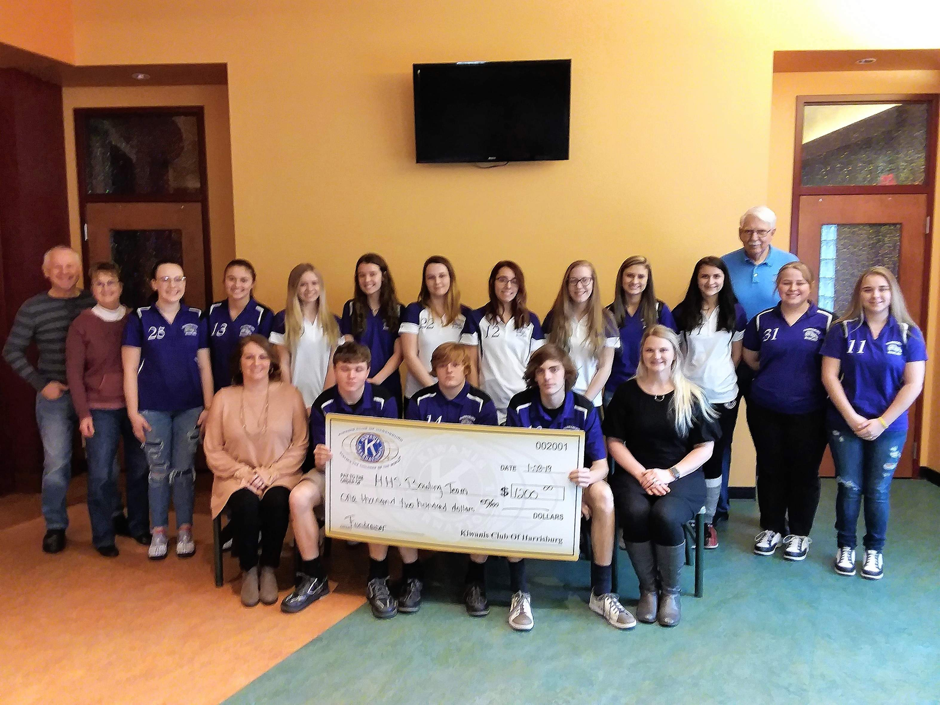 Members of the Harrisburg High School girls and boys bowling teams and Harrisburg Kiwanis Club members gather for a check presentation.