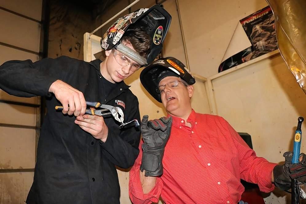 Carmi High School graduate and SIC welding student Zachary Coale shares some tungsten inert gas welding techniques with Carmi Ag teacher Bob Lamp.
